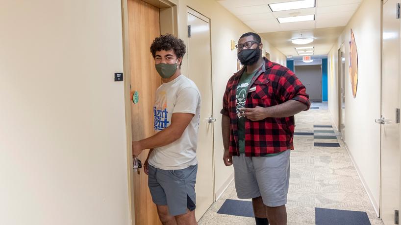 Elijah Batiste enters his room in Oak Hall