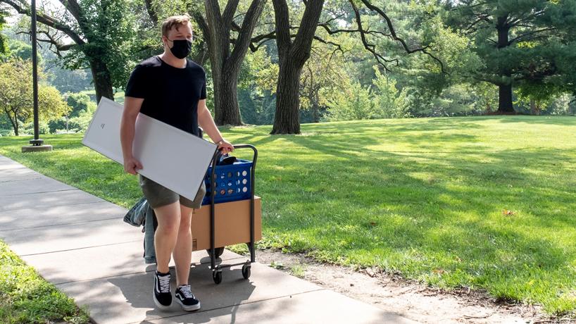 Christian Mana moves his belonging into oak hall