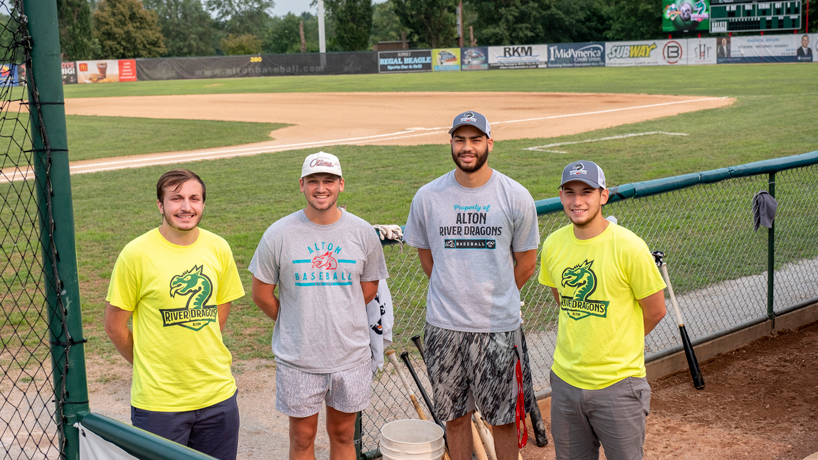 Alton River Dragons interns posing on baseball field