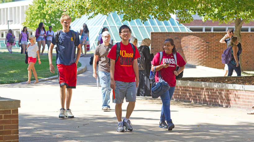 students walking on UMSL Quad