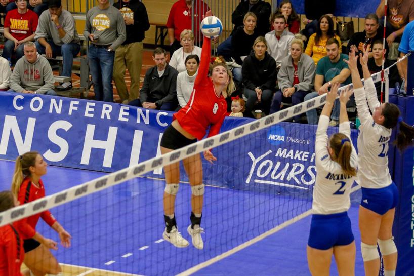 Charlotte Richards spiking the ball against Rockhurst