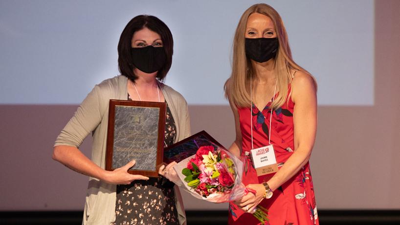 Lauren Schoellhorn accepts an award for district teacher of the year